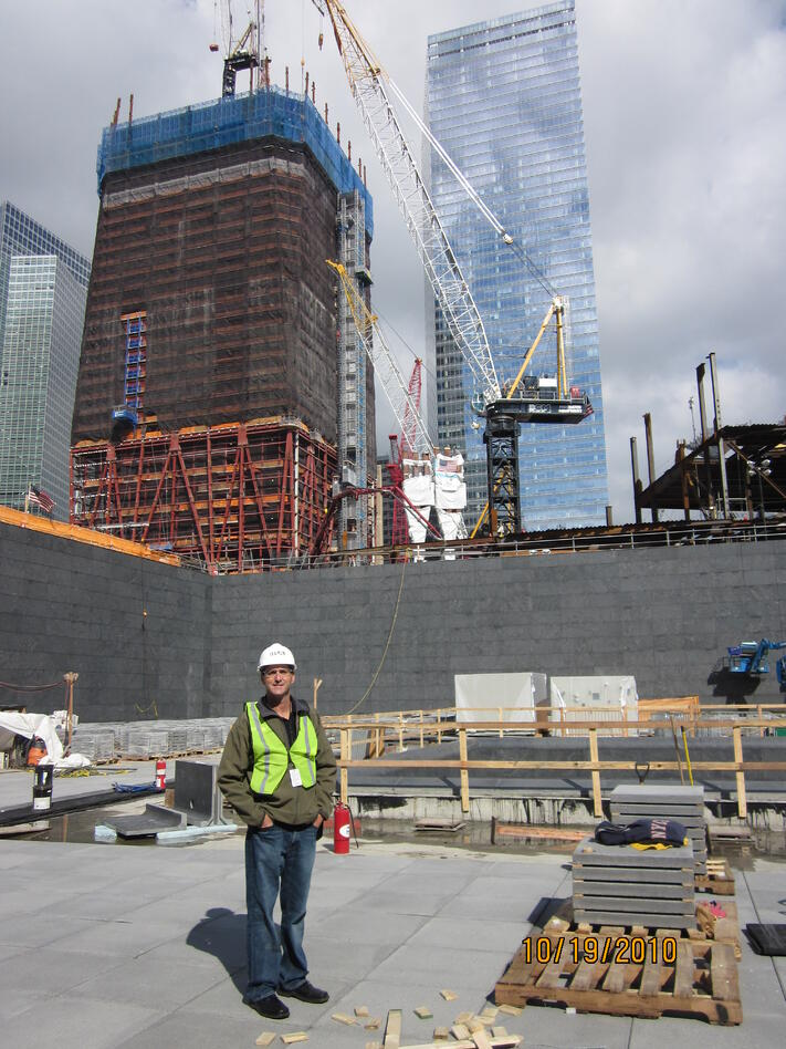 Marc_Inside_WTC_Memorial_Fountain_-_Tower_1_and_7_in_Background.jpg